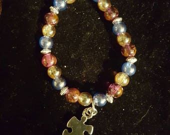 Childs multi colored braclet with puzzle piece