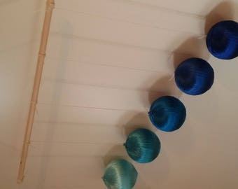 Blue Gobbi mobile made of real silk yarn from the Montessori