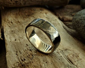 Handcrafted Silver Ring with hammered texture.