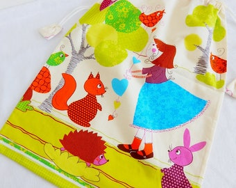 """Great bag patterns """"girl and woodland animals"""" on an ecru background, off white back"""