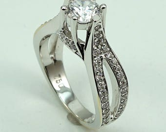 Engagement Ring 18K WG CZ Center Stone with 62-Diam Side Stones at 0.58 Cts.