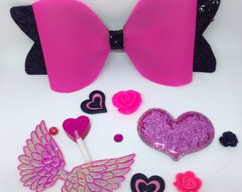 5.5 inch Pink jelly bow with black glitter tails