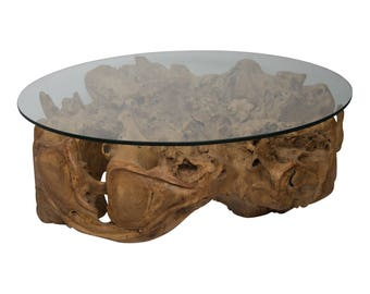 Unique coffee table from teak stump with glass plate
