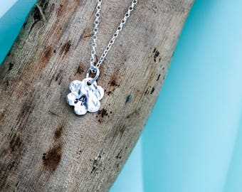 Handmade sterling silver tiny hammered flower which can be personalised with one letter.