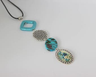 Vertical and original, turquoise, acrylic and silver necklace with cabochon flower bouquet.