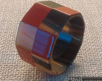 Horn bangle with red lacquer