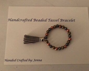 Handcrafted Beaded Bracelet with Tassel Charm