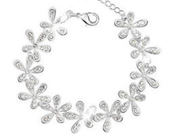 Silver flower bracelet with rhinestones