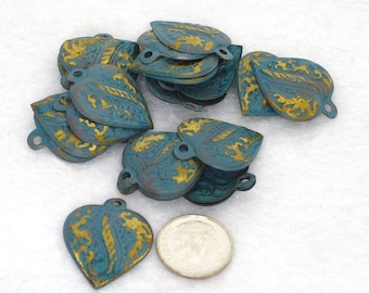 Turquoise colored brass heart