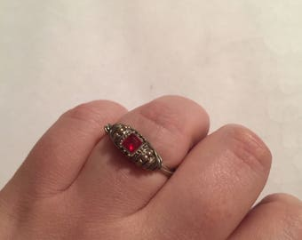 Size 10 1/2 red and sliver wire wrapped ring. Plus size!