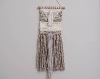 Hand woven wall hanging in creams