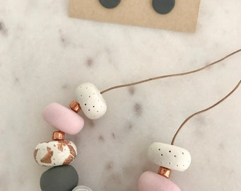 Beautiful white, pink and copper polymer  clay necklace and charcoal earrings