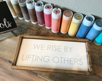 """We rise by lifting others Wood Sign 8"""" x 18"""""""