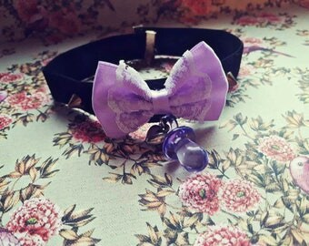 Black choker with a purple bow, purple pacifier and spikes pastel kawaii kitten play ddlg