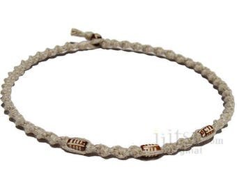 Natural twisted hemp with three brown cylindrical bone beads