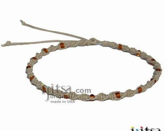Natural twisted hemp necklace with small amber glass beads throughout