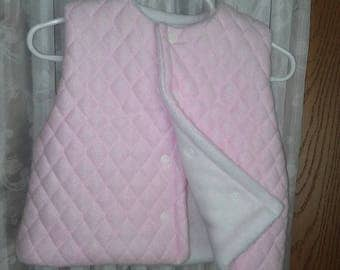 Girls 6 to 12 month pink quilted fleece vest. Lined item. Snap front. Great end of winter, springtime outerwear.