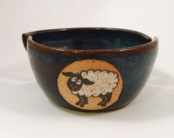 Sheepy yarn bowl with two slots in floating blue