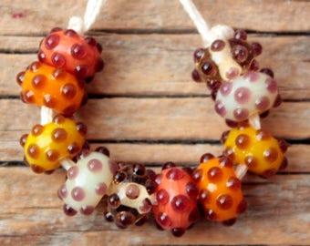 Bumpies #1- A set of 10 lampwork beads