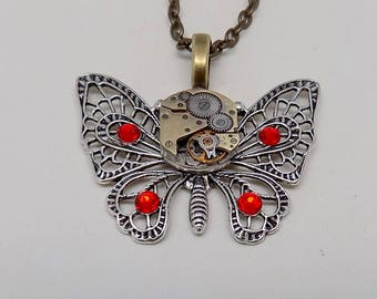 Steampunk butterfly pendant necklace with a vintage watch.Steampunk jewelry