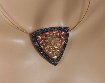 Polymer clay pendant, shield, black, gold, copper