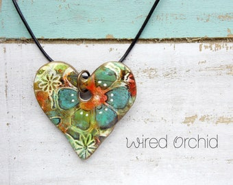 Polymer Clay Heart Pendant Jewelry featuring a Grunge Boho Floral Design in Teal, Orange, Lime, Brown and White