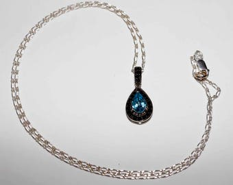 Genuine swiss blue Topaz and black spinel tear drop pendant comes with sterling silver chain