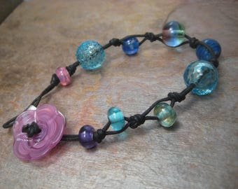 Beads on cord, a glass bead bracelet
