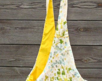 Pet sling in yellow, green and white