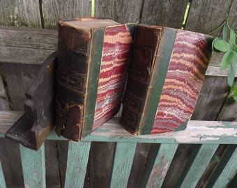 Two shabby, chippy,distressed antiquarian, leather and marbelized covers vintage books 1800s