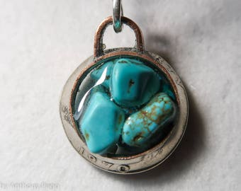 Turquoise shards set in hand hammered 1970 US quarter pendant featuring Oklahoma red dirt