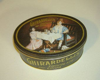 Vintage 1990's Ghirardelli's Cocoa Chocolate Tin. Oval Navy Blue Tea Party Theme. 6.5""