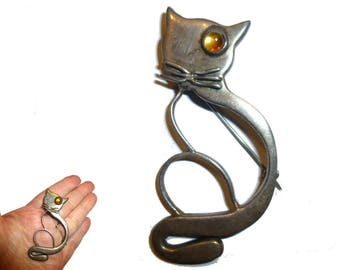 """Silver Cat Pin with Glass Eye. Idella La Vista Modernist Studio Sterling Brooch.  NYC 1950s. Kitty Cat Measures about 2.5"""" tall."""
