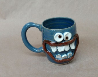 Face Coffee Cups. 14 - 16 Ounces. Hamburger Lover Happy Smiley Face Mug. Hot Cocoa Soup Beer Mug. Blue Ceramic Mug. Dishwasher Safe Pottery.