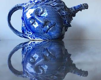 Blue face teapot sculpture pottery head vessel, slip trailing texture drips bust portrait cobalt glazed dreamer surreal art