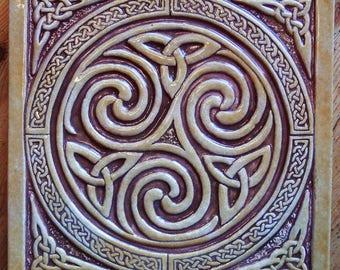 Relief carved Celtic spiral ceramic tile