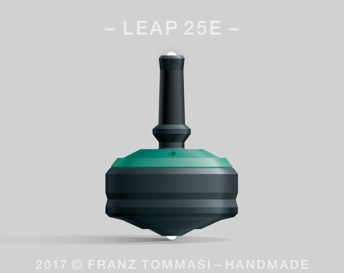 LEAP 25E Green-on-Black Spin Top with green cover over black body, ergonomic stem with rubber grip, dual ceramic tip, and 3 accent holes