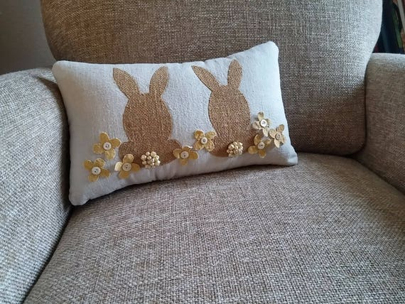 Decorative canvas front pillow featuring burlap bunnies and flowers