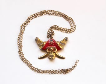 Vintage 1960s Pirate Skull Jolly Roger Pendant with Red Rhinestone Eyes and Gold Tone Chain