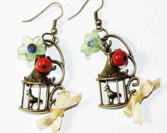 Antique gold tone bird cage earrings, satin