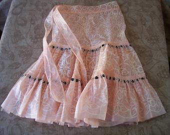 Vintage 1950s pink plastic apron.  C2-586-1