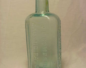 c1890s J. E. Combault's Caustic Balsam The Lawrence Williams Co. U.S. and Canada, Aqua Cork Top Medicine Bottle