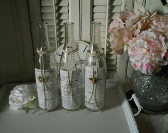 Jeanne d' Arc Style Nordic Decor Clear Wine Bottle With French Paper Label Tied With Ecru Twine And Vintage Rhinestone Gem Bottle Container