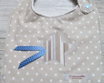 Star for small greedy, beige blue bib