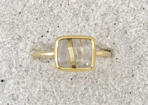 Rutilated quarts and solid 18k gold ring