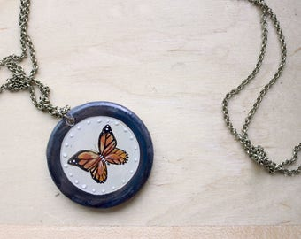 Monarch Medallion Necklace- Hand painted monarch butterfly pendant made of wood and covered in resin
