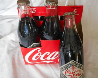 Six pack vintage 10 oz Coca-Cola bottles 75th Anniversary UNOPENED