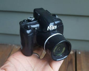Nikon camera phone dock, phone mount, phone holder, camera sculpture.