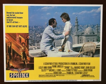 Lobby card from movie Sphinx with Frank Langella and Leslie Anne Down.