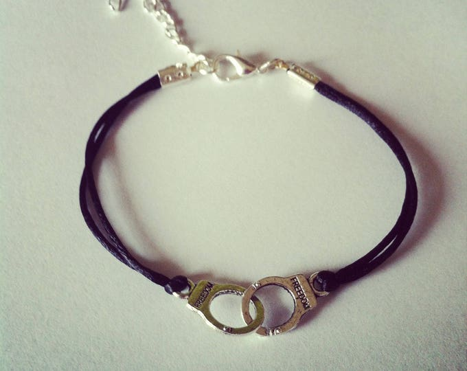 Black cord with handcuffs silver bracelet